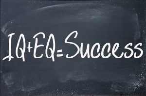 IQ plus emotional intelligence equals success formula on blackboard